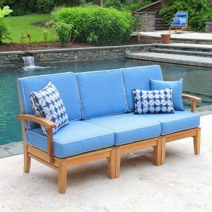 Calypso teak sectional sofa with cushions in Capri