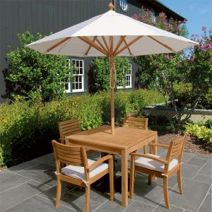 Calypso dining collection with 8 ft. teak patio umbrella in Oyster.