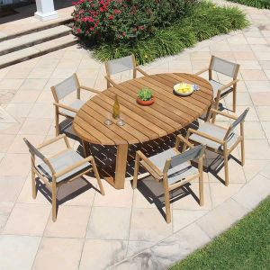 Eclipse 7 ft. oval teak dining table with Summit stacking armchairs.