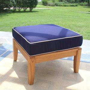Calypso ottoman in Navy with Oyster piping.
