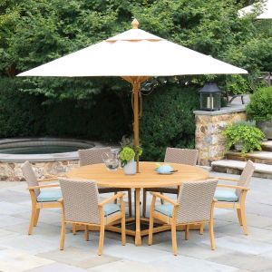 Minton round teak table with Elgin dining chairs and 10 ft. outdoor teak umbrella in Almond.