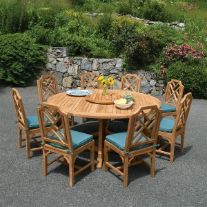Minton round teak table with Chippendale dining chairs and Cucina lazy susan