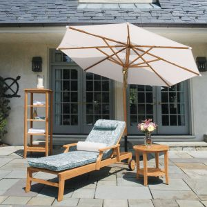Seneca teak chaise lounge with Lagoon Wisp cushion and teak 10 ft. tilting umbrella.