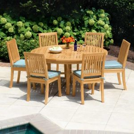 Seneca 59 in. round teak outdoor table with Seneca armchairs.
