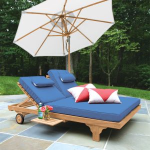 Shelbourne teak double chaise lounge, shown with cushion in Sapphire Blue.