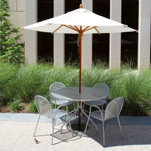 Siena table and chairs with Eucalyptus 8 ft. hexagon umbrella in Oyster.