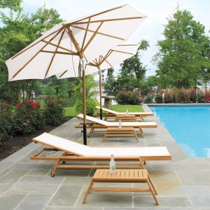 Teak 10 ft. tilting patio umbrella in Oyster with Summit stacking chaises.