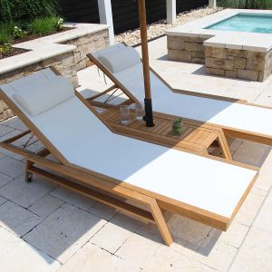 Summit teak umbrella side table with Summit stacking chaises and 90 lb. rolling base