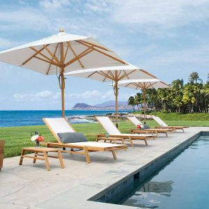 Teak 9 ft. square outdoor umbrellas with Summit stacking chaises.