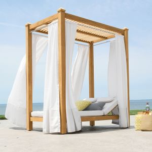 Vista double chaise poolside cabana with slatted ceiling and curtains.